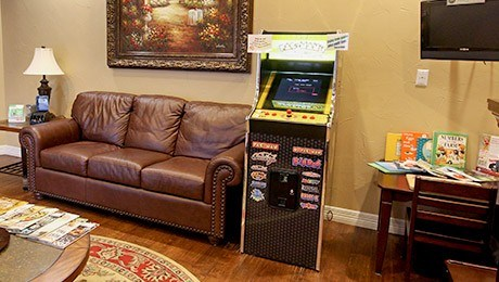 Comfortable couch and arcade game