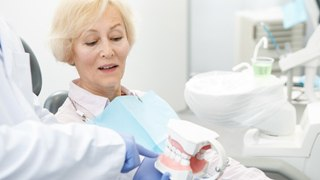 older woman consulting with dentist