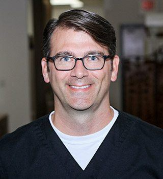 Headshot of the Colony Dentist Dr. Austin Amos