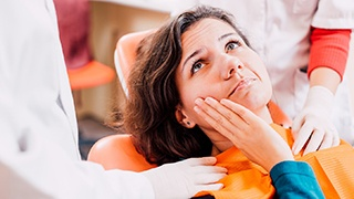 The Colony Emergency Dentist Worried lady holding cheek