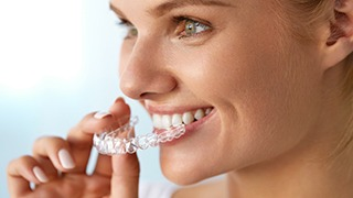 The Colony orthodontics lady fitting clear aligner