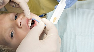 child receiving dental examination