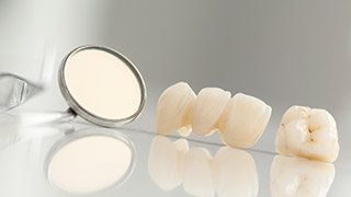 The Colony General Dentistry dental mirror on table
