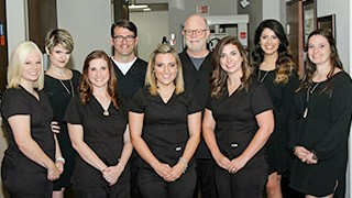 The Colony Dental Services Ridgepointe Dental Team smiling