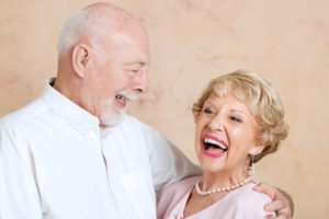 older couple embracing and smiling