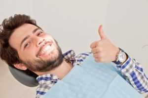 Man smiling in dentist's chair.