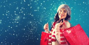 woman smiling for holidays red bags