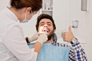 man smiling thumb up dental visit