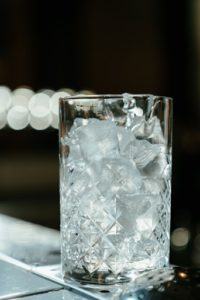 Glass full of ice on counter